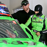 Danica Patrick, driver of the #7 GoDaddy Chevrolet climbs into her car in the garage area during practice for the 60th Annual NASCAR Daytona 500 auto race at Daytona International Speedway on Friday, February 16, 2018 in Daytona Beach, Florida.  (Alex Menendez via AP)