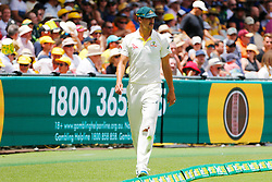 Australia's Mitchell Starc tears his pants at his knee during day two of the Ashes Test match at The Gabba, Brisbane.