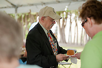 Bruce Corrette enjoys the BBQ lunch provided by Kiwanis volunteers in honor of the 70th anniversary celebration for the Kiwanis Pool in St. Johnsbury Vermont.  Karen Bobotas / for Kiwanis International