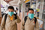 Apr. 27, 2009 -- NOGALES, SONORA, MEXICO: School boys walk home with surgical masks on after their school was closed in Nogales, Sonora, Mexico Monday. The Mexican government broadened its efforts to control the outbreak of swine flu Monday closing schools throughout the country. In Nogales, on Mexico's northern border with the US, people started wearing masks as news of the outbreak spread.  Photo by Jack Kurtz