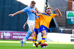 Liam Delap of Manchester City U21 and Aaron O'Driscoll of Mansfield Town chase down the ball - Mandatory by-line: Ryan Crockett/JMP - 08/09/2020 - FOOTBALL - One Call Stadium - Mansfield, England - Mansfield Town v Manchester City U21 - Leasing.com Trophy