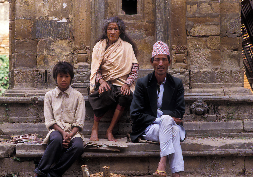 Passing the time seated on the stone steps of one of the many temples and shrones surrounding  Durbar Square, Kathmandu