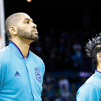 01 November 2015: Charlotte Hornets forward Nicolas Batum (5) is seen next to Charlotte Hornets guard Jeremy Lin (7) during the national anthem prior to the Atlanta Hawks 94-92 victory over the Charlotte Hornets, at the Time Warner Cable Arena, in Charlotte, North Carolina, USA.