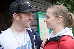 Teenage Couple smiling at one another,