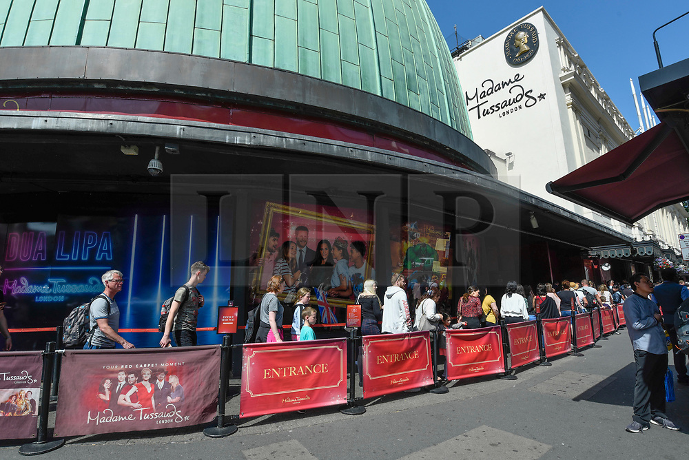 © Licensed to London News Pictures. 28/06/2019. LONDON, UK.  Tourists queue up to enter Madame Tussauds near Baker Street.  Danish company Kirkbi Invest, which controls the Lego toy firm, has agreed to pay £4.8bn for Merlin Entertainments.  Merlin owns the Madame Tussauds as well as the London Eye, Alton Towers, Chessington Adventures as well as other UK attractions.  Photo credit: Stephen Chung/LNP