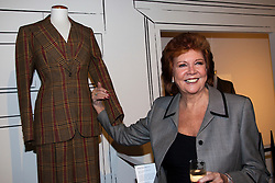 """© under license to London News Pictures. LONDON, 19/05/2011. Cilla Black standing next to one of the dresses she loaned to he exhibition. Opening of the Tommy Nutter Exhibition """"Rebel on the Row"""" at the Fashion and Textile Museum, London. Photo credit should read BETTINA STRENSKE/LNP"""
