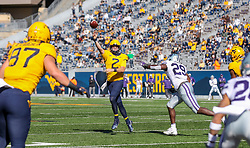 Oct 31, 2020; Morgantown, West Virginia, USA; West Virginia Mountaineers quarterback Jarret Doege (2) throws a pass during the second quarter against the Kansas State Wildcats at Mountaineer Field at Milan Puskar Stadium. Mandatory Credit: Ben Queen-USA TODAY Sports