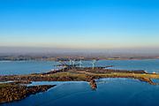 Nederland, Zuid-Holland, Goeree-Overflakkee, 07-02-2018; zicht op Hellegatsplein, verkeersknooppunt tussen de A29 en de N59 gelegen op het kunstmatige eiland Hellegatsplaat en onderdeel van de Volkerakwerken (onderdeel van de Deltawerken). Het Hellegatsplein ligt in het Hellegat, onderdeel van het water van het Volkerak (voorgrond), verder links het Haringviet, rechts Hollandsch Diep.<br /> Artificial island and traffic junction in the Haringvliet estuary.<br /> luchtfoto (toeslag op standard tarieven);<br /> aerial photo (additional fee required);<br /> copyright foto/photo Siebe Swart