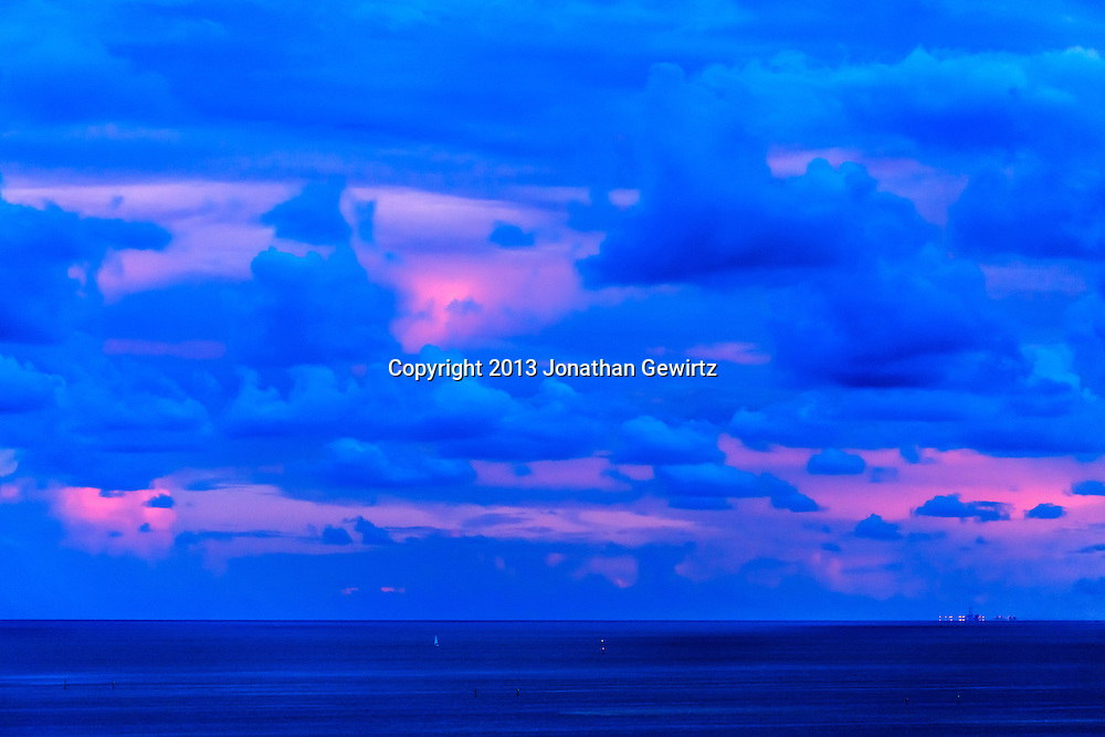 Pastel pinks of a fading sunset contrast with bluish clouds over southern Biscayne Bay.<br /> <br /> WATERMARKS WILL NOT APPEAR ON PRINTS OR LICENSED IMAGES.