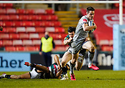 Sale Sharks full back Luke James breaks past Leicester Tigers centre Matt Scott during a Gallagher Premiership Round 7 Rugby Union match, Friday, Jan. 29, 2021, in Leicester, United Kingdom. (Steve Flynn/Image of Sport)