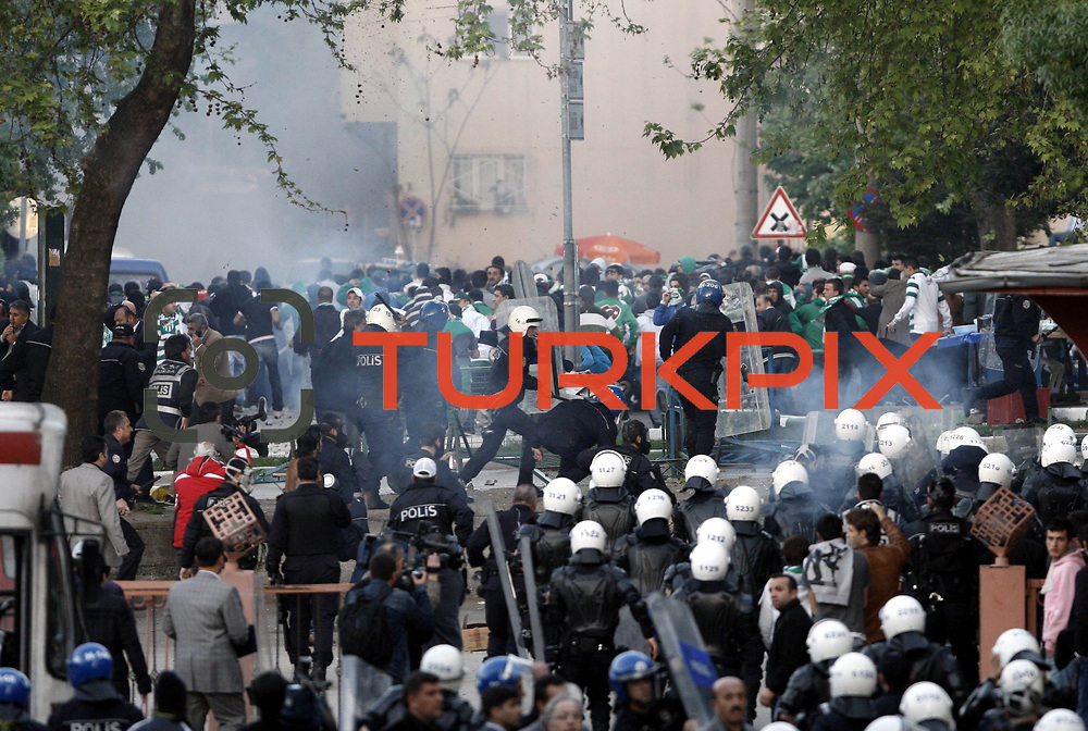 Bursaspor supporters clashed with police in front of the stadium. Police used tear gas and water cannons to disperse the demonstrators panzers. On events in the match played between Besiktas Bursaspor has been canceled. Similar events took place in Istanbul in December last year a large number of supporters injured bursaspor blade 4 of them had been assaulted them. Bursaspor supporters with sticks and stones at police during assault 8at Ataturk Stadium in Bursa Turkey on Saturday, 07 May 2011. Photo by TURKPIX