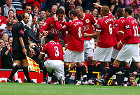 Old Trafford Manchester Premiership 20.08.2006<br />Manchester United v Fulham <br />Wayne Rooney  and Cristiano Ronaldo (Manchester United) are pals again after fourth goal and Patice Evra kisses his boots for good measure<br />Photo Roger Parker Fotosports International