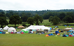 © London News Pictures. 17/08/2013. Balcombe, UK. A general view of a camp site organised by campaign group No Dash For Cash in Balcombe, West Sussex which has been earmarked for fracking. Cuadrilla has temporarily ceased drilling at the site under advice from the police after campaign group No Dash For Gas threatened a weekend of civil disobedience. Photo credit: Ben Cawthra/LNP