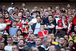 Manchester United fans watch nervously from the stands during the Emirates FA Cup Final at Wembley Stadium, London.