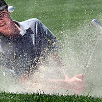 Harbor High golfer Jack Heavey blasts out of a trap during the SCCAL golf championship tournament at Pasatiempo Golf Course in Santa Cruz, California on Tuesday April 28, 2015. Heavy carded a 79 to finish third.