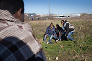 Calais, France, 27 feb 2015, Situation of the migrants in Calais, living in jungles. A group of Sudanese young guys pose for a picture by a friend taken with his phone.
