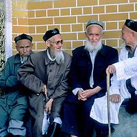 Uygur elders chat outsidea  mosque in Kashgar, Xinjiang Province, China.