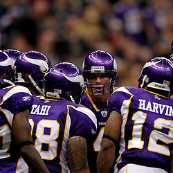 September 9, 2010; New Orleans, LA, USA;  Minnesota Vikings quarterback Brett Favre (4) talks to teammate in the huddle during the NFL Kickoff season opener at the Louisiana Superdome. The New Orleans Saints defeated the Minnesota Vikings 14-9.  Mandatory Credit: Derick E. Hingle