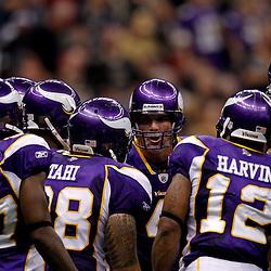 September 9, 2010; New Orleans, LA, USA;  Minnesota Vikings quarterback Brett Favre (4) talks to teammate in the huddle during the NFL Kickoff season opener at the Louisiana Superdome. The New Orleans Saints defeated the Minnesota Vikings 14-9.  Mandatory Credit: Derick E. Hingle