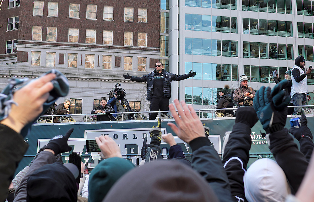 Eagles tight end Zach Ertz is cheered by fans as members of the organization celebrate their Super Bowl LII win during a parade Feb. 8, 2018, in front of millions gathered in downtown Philadelphia, Pennsylvania. (Photo by Matt Smith)