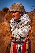 Spectator, Bactrian camel race, 25km across winter landscape of Gobi desert during Bulgan's 'festival of a thousand camels' , Mongolia