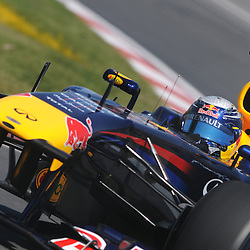 German Sebastian Vettel, reigning World Drivers Champion, drives the Red Bull Racing RB7 during practice for the 2011 Formula 1 Canadian Grand Prix, Montral, QC.