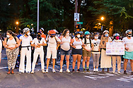 Portland Protests in downtown Portland, Oregon. Heather Hawksford, (pregnant), heatherhawksford@gmail.com is part of the group of moms who came to form a human chain in front of the Justice Center.