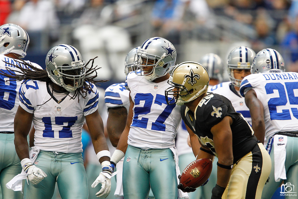 Dallas Cowboys wide receiver Dwayne Harris (17) and strong safety Eric Frampton (27) celebrate after stoping the New Orleans Saints punt return at Cowboys Stadium in Arlington, Texas, on December 23, 2012.  (Stan Olszewski/The Dallas Morning News)