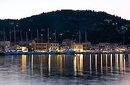 Sailing yachts moored at dusk in the Gaios harbour on Paxos, The Ionian Islands, Greece, Europe