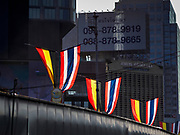 10 MAY 2018 - BANGKOK, THAILAND: Belgian and Thai flags on the Thai Belgian Bridge in Bangkok. The bridge is an overpass over a congested Bangkok intersection and was built with Belgian aid money. The flags were flying to mark 150 years of diplomatic relations between Belgium and Thailand.        PHOTO BY JACK KURTZ