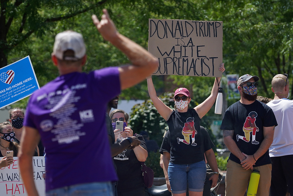 A man yells at supporters of the Black Lives Matter movement Amber Daniels, left, of Emmaus, and Jeremy Hatz, right, of Emmaus, as they turned out to counter a Pro-Trump Flag Rally held at the triangle on Chestnut Street in Emmaus, Pennsylvania. (Photo by Matt Smith)