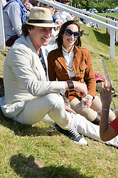 TIM ATTIAS and ELIZABETH DANA at the St.Regis International Polo Cup at Cowdray Park, Midhurst, West Sussex on 16th May 2015.