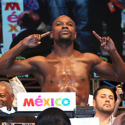 LAS VEGAS, NV - SEPTEMBER 12: WBC/WBA welterweight champion Floyd Mayweather Jr. poses on the scale during his official weigh-in at the MGM Grand Garden Arena on September 12, 2014 in Las Vegas, Nevada. Mayweather Jr. will defend his titles against Marcos Maidana on September 13 in Las Vegas.  (Photo by Alex Menendez/Getty Images) *** Local Caption *** Floyd Mayweather Jr; Marcos Maidana