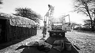 Lydia Orre, loading truck for market, Ngurunit, Kenya. MR#42 (assisted by Simon Lekesike, MR#43)