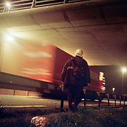 Khalid, an asylum seeker from Afghanistan, walks towards the Eurotunnel near Sangatte. He makes nightly attempts to cross the English Channel to Dover from the Red Cross refugee camp near Calais...Picture taken April 2002 in Sangatte by Justin Jin. Copyright 2002 by Justin Jin.