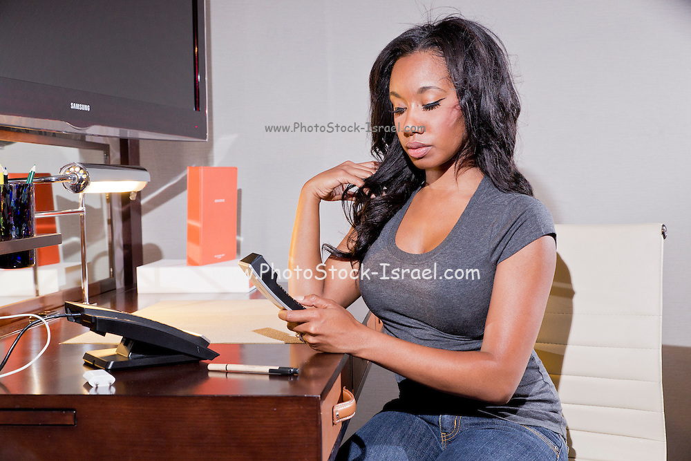 Young African American Woman working at a desk