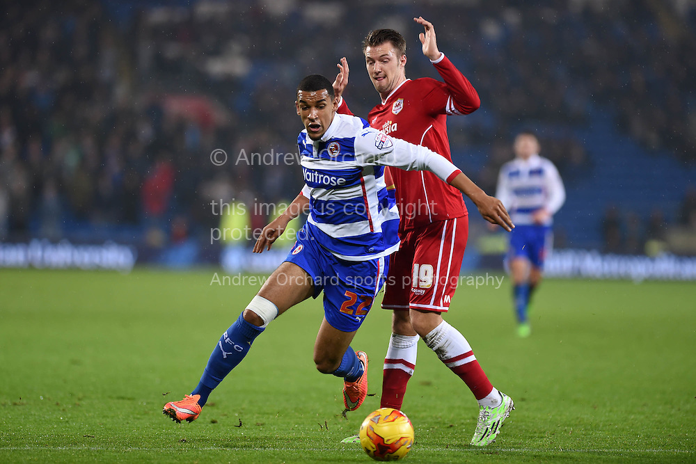 Reading's Nick Blackman breaks away from Cardiff's Anthony Pilkington. Skybet football league championship match, Cardiff city v Reading at the Cardiff city stadium in Cardiff, South Wales on Friday 21st November 2014<br /> pic by Andrew Orchard, Andrew Orchard sports photography.