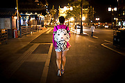 "A Chinese woman walks on the streets wearing a white tiger shaped bag in the city centre of Datong, China, July 23, 2014.<br />   <br /> This picture is part of the series ""Urban Chinese Streets"", a journey on the streets of Chinese cities to discover their modern citizens and habits.      <br /> <br /> © Giorgio Perottino"