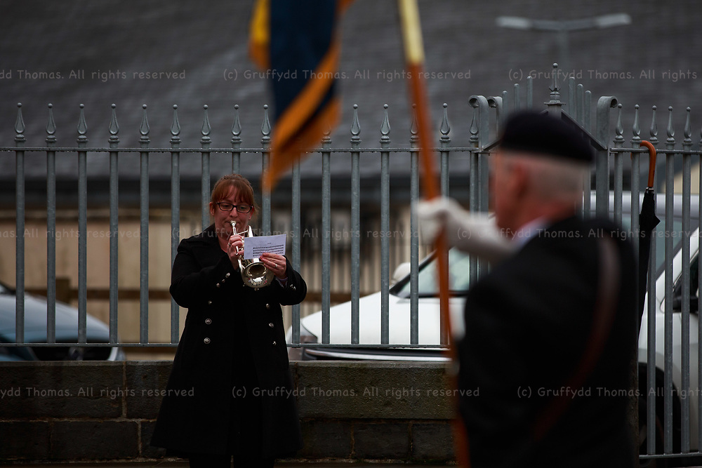 """Carmarthen, Carmarthenshire, Wales, UK. 8 November, 2020.<br /> Due to Covid-19 """"fire break"""" restrictions, a scaled-back Remembrance Day parade in Carmarthen, Carmarthenshire, west Wales. A trumpeter plays Reveille.<br /> Credit: Gruffydd Ll. Thomas"""
