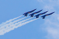 Four Blue Angels Flying Upside Down in Formation