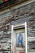SHOT 10/15/11 10:42:09 AM - A religious pictograph in a doorway of an abandoned home in Buffalo, N.Y. Buffalo, N.Y. is the second most populous city in the state of New York and is located in Western New York on the eastern shores of Lake Erie and at the head of the Niagara River. Buffalo is the seat of Erie County and the principal city of the Buffalo-Niagara Falls metropolitan area, the largest in Upstate New York. (Photo by Marc Piscotty / © 2011)