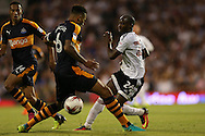 Sone Aluko of Fulham challenges Jamaal Lascelles of Newcastle United. Skybet EFL championship match, Fulham v Newcastle Utd at Craven Cottage in Fulham, London on Friday 5th August 2016.<br /> pic by John Patrick Fletcher, Andrew Orchard sports photography.