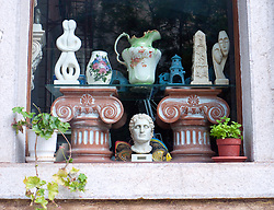 Antique shop window display in Old Town of Kerkyra on Corfu in Greece