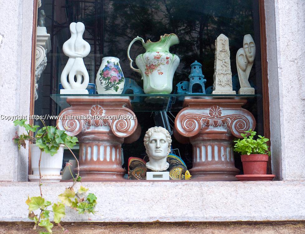 Antique shop window display in Old Town of Kerkyra on Corfu in Greece