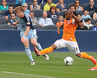Football - Major League Soccer - Houston Dynamo at Sporting KC - The Sporting KC and the Houston Dynamo played to a 1-1 tie in regulation time at Sporting KC Park in Kansas City, Kansas, USA.  Sporting KC midfielder Jacob Peterson (37, left) and Houston Dynamo midfielder Corey Ashe (26) in action in the first half. .