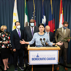 Nine Texas Democratic senators, including Sen. Carol Alvarado, D-Houston, at the mic,  who supported their House quorum-busting colleagues in Washington, D. C. return to the Texas Capitol on July 21, 2021 and explained their opposition to voting bills in the special session.