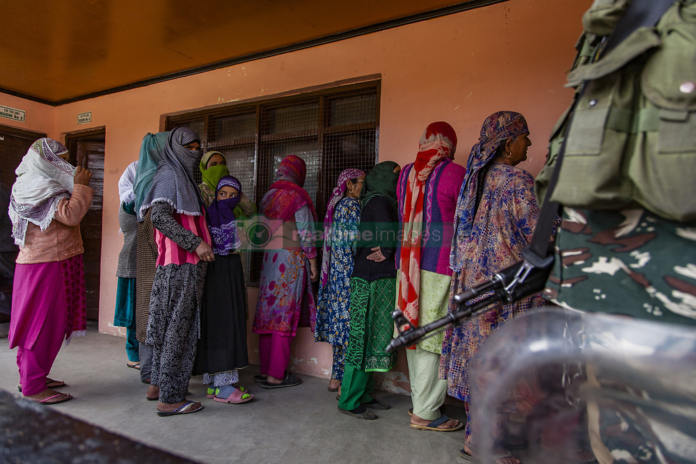October 10, 2018 - Srinagar, Jammu and Kashmir, India - Indian government forces guard a deserted polling station,  during the second phase of municipal polls,  on October 10, 2018 in Srinagar, the summer capital of Indian administered Kashmir, India. Poor voter turnout marked the second phase of municipal elections in Kashmir amid a partial shutdown and heavy deployment of government forces across the region.  Pro-independence groups have rejected the polls as farce and  called for a boycott while major pro-India parties like National Conference and Peoples Democratic Party (PDP) also stayed away from the electoral process alleging Indian governments attempts to alter the special status accorded to the disputed Himalayan region in the countrys Constitution. (Photo by Kabli Yawar/Nur Photo) (Credit Image: © Kabli Yawar/NurPhoto via ZUMA Press)