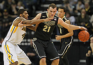 February 27 2013: Purdue Boilermakers guard/forward D.J. Byrd (21) keeps the ball away from Iowa Hawkeyes guard/forward Roy Devyn Marble (4) during the first half of the NCAA basketball game between the Purdue Boilermakers and the Iowa Hawkeyes at Carver-Hawkeye Arena in Iowa City, Iowa on Wednesday, February 27 2013.