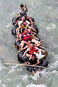 Local people rafting through the rapids of the Bahorok River in the village of Bukit Lawang in northern Sumatra, Sumatra, Indonesia