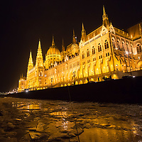 Floating ice is seen on the Danube River in front of the Hungarian Parliament building in Budapest, Hungary on January 09, 2017. ATTILA VOLGYI